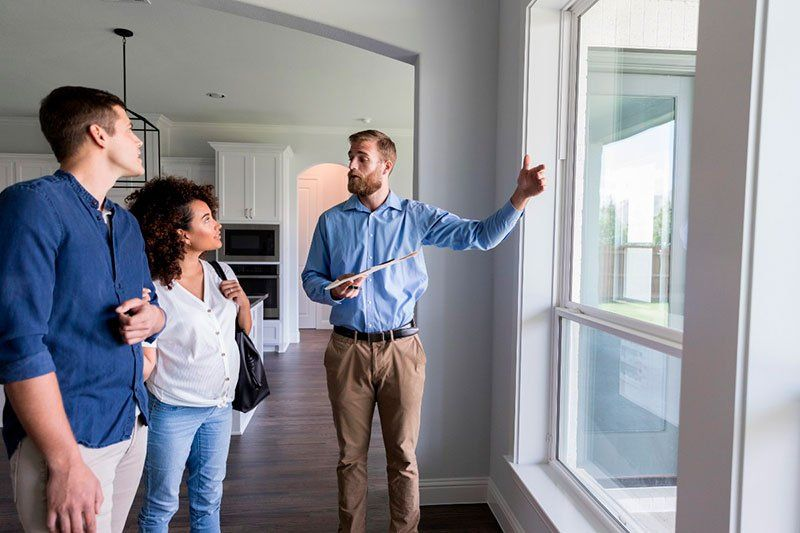 Realtor showing the house to a couple of buyers